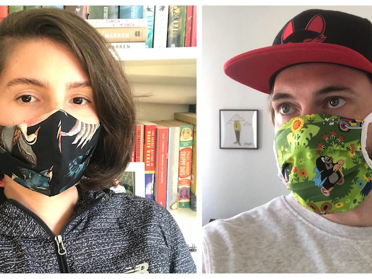 Woman and man wearing face masks